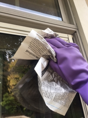 Use newspaper to wipe off excess cleaning fluid